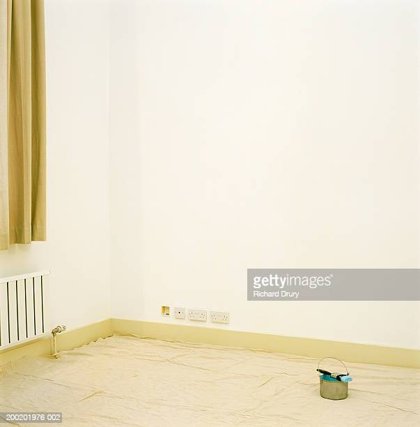 dust sheet covering floor in room, paintbrush resting on pot - richard drury stock pictures, royalty-free photos & images
