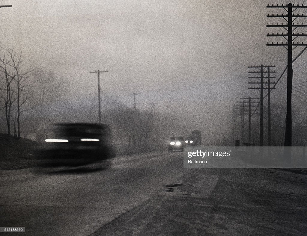 03762133f146 Dust Storm Coats Middle West with Kansas Soil. A scene on a highway ...