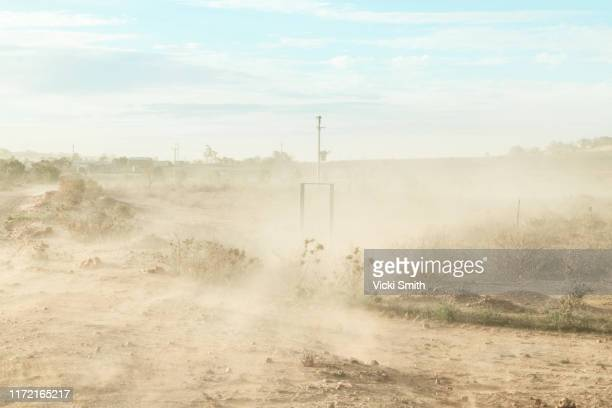 dust storm on a country road in the dry, drought area of australia - dust storm stock pictures, royalty-free photos & images