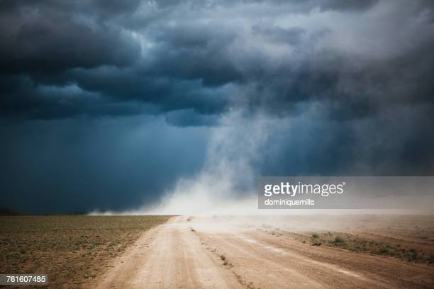 dust storm on a dirt road, ulgii, mongolia - dust storm stock pictures, royalty-free photos & images
