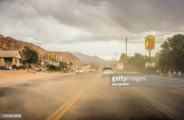 dust storm on a road in utah - dust storm stock pictures, royalty-free photos & images