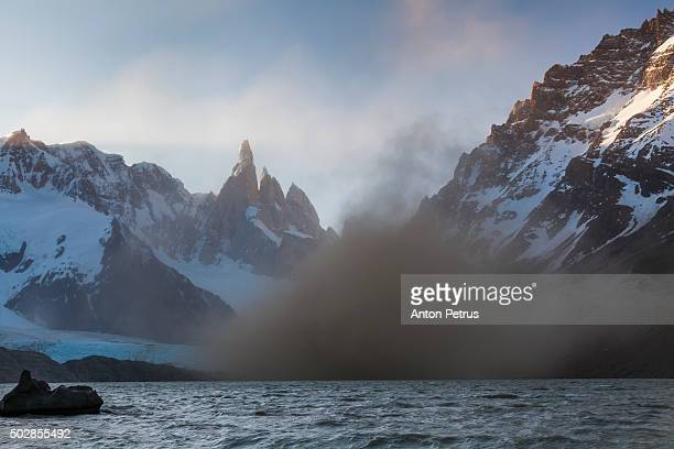 dust storm on the lake torre at mount cerro torre - anton petrus stock pictures, royalty-free photos & images