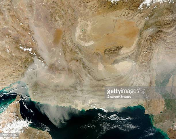 A dust storm stretching from the coast of Pakistan to the Strait of Hormuz.