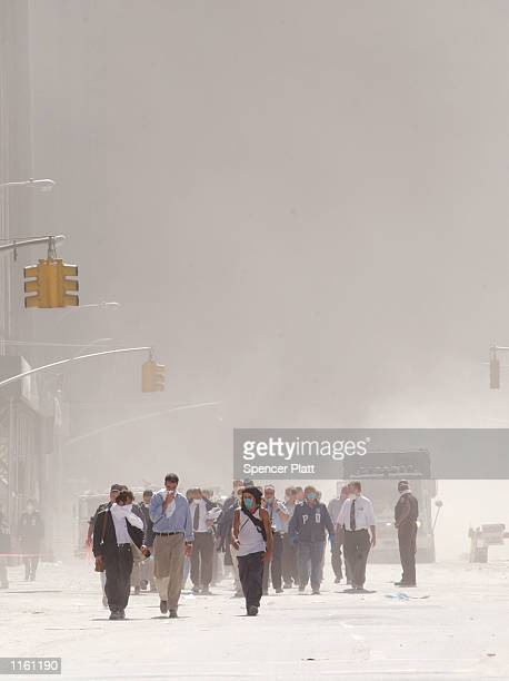 Dust swirls around south Manhattan moments after a tower of the World Trade Center collapsed September 11 2001 in New York City after two airplanes...