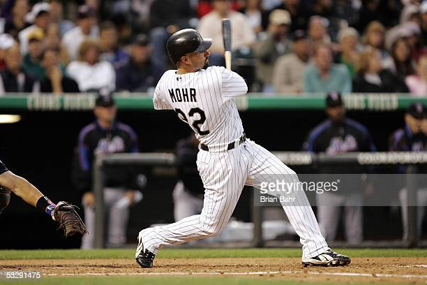 Dustan Mohr of the Colorado Rockies follows through on a tworun home run against Kazuhisa Ishii of the New York Mets in the third inning on July 26...