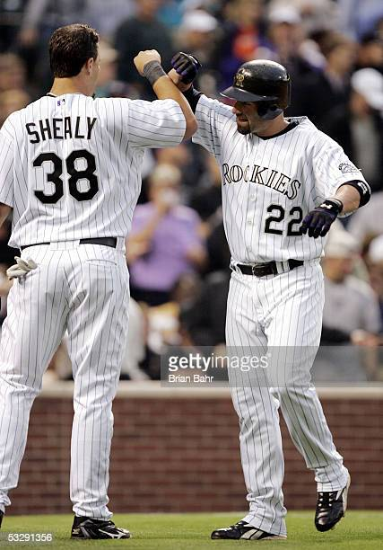 Dustan Mohr of the Colorado Rockies gets a high five for his two run home run from Ryan Shealy against Kazuhisa Ishii of the New York Mets in the...