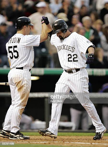 Dustan Mohr of the Colorado Rockies gets a high five from Danny Ardoin for his a tworun home run against Kazuhisa Ishii of the New York Mets in the...