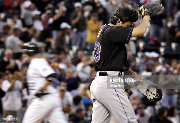 Dustan Mohr of the Colorado Rockies rounds the bases after his two run home run against Kazuhisa Ishii of the New York Mets in the third inning on...