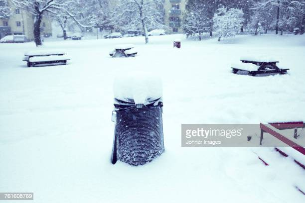dustbin and picnic tables in winter - chilly bin stock photos and pictures