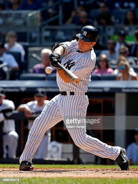 Dustin Ackley of the New York Yankees hits a sacrifice fly in the second inning against the Toronto Blue Jays at Yankee Stadium on September 13 2015...