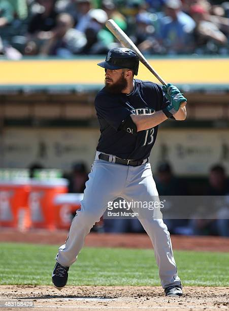 Dustin Ackley of the Seattle Mariners bats against the Oakland Athletics during the game at Oco Coliseum on Sunday April 6 2014 in Oakland California