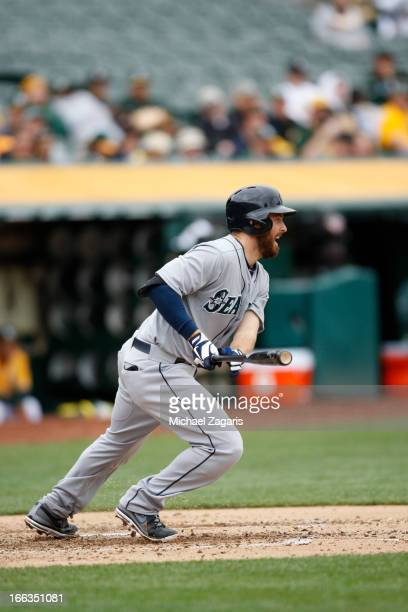 Dustin Ackley of the Seattle Mariners bats during the game against the Oakland Athletics at Oco Coliseum on April 4 2013 in Oakland California The...