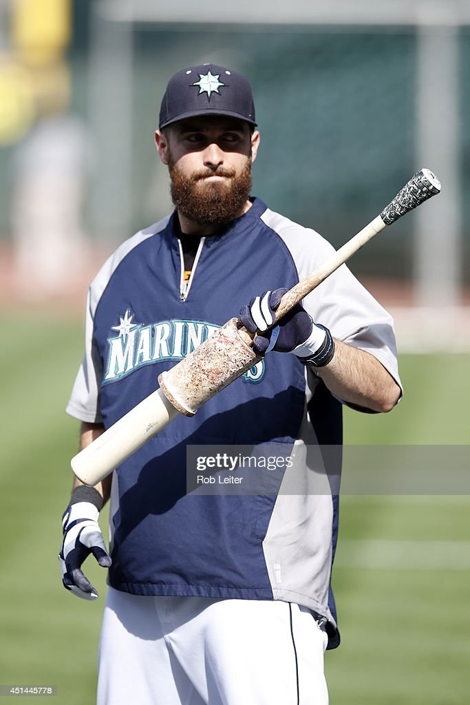Dustin Ackley #13 of the Seattle Mariners looks on during batting practice before the game against the New York Yankees at Safeco Field on June 11, 2014 in Seattle, Washington. The Yankees defeated the Mariners 4-2.