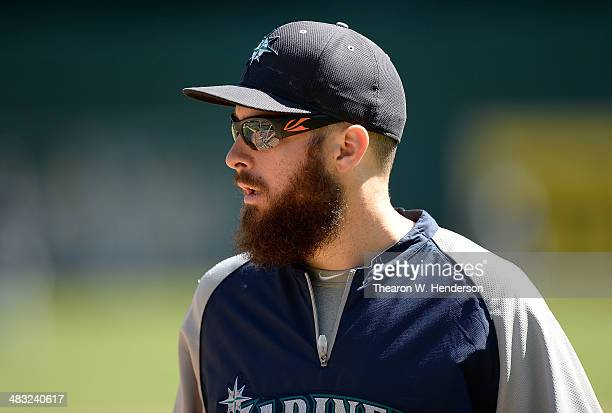 Dustin Ackley of the Seattle Mariners looks on during batting practice prior to his game against the Oakland Athletics at Oco Coliseum on April 5...