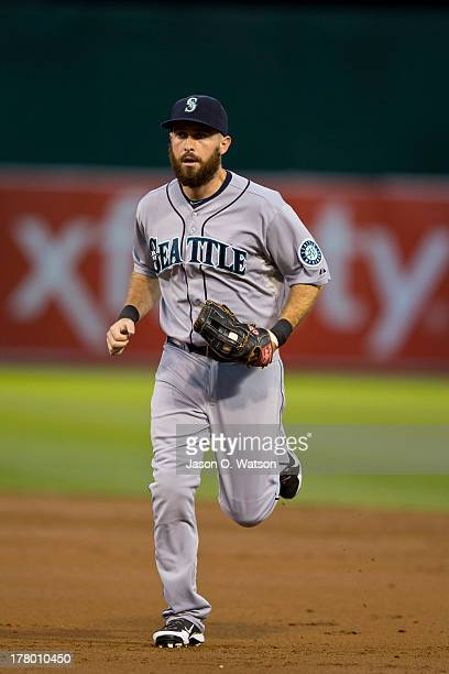 Dustin Ackley of the Seattle Mariners returns to the dugout during the third inning against the Oakland Athletics at Oco Coliseum on August 19 2013...