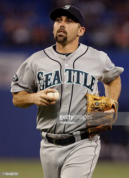 Dustin Ackley of the Seattle Mariners runs in after a third out during MLB action against the Toronto Blue Jays at The Rogers Centre July 19 2011 in...