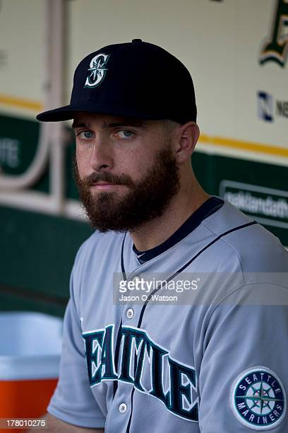 Dustin Ackley of the Seattle Mariners sits in the dugout before the game against the Oakland Athletics at Oco Coliseum on August 19 2013 in Oakland...