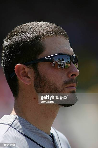 Dustin Ackley of the Seattle Mariners stands for the seventh inning stretch during the game against the Los Angeles Angels of Anaheim at Angel...