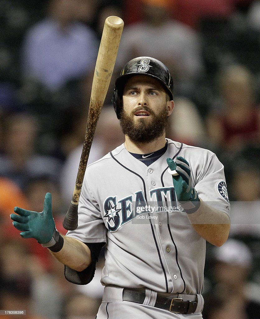 Dustin Ackley #13 of the Seattle Mariners strikes out in the seventh inning against the Houston Astros at Minute Maid Park on August 29, 2013 in Houston, Texas.