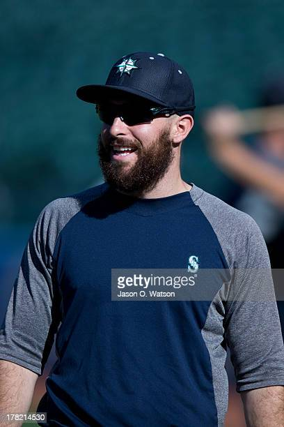 Dustin Ackley of the Seattle Mariners warms up before the game against the Oakland Athletics at Oco Coliseum on August 20 2013 in Oakland California...