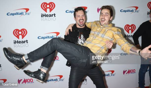 Dustin Belt and Kendall Schmidt from Heffron Drive pose in the press room during Z100's Jingle Ball 2018 at Madison Square Garden on December 7 2018...