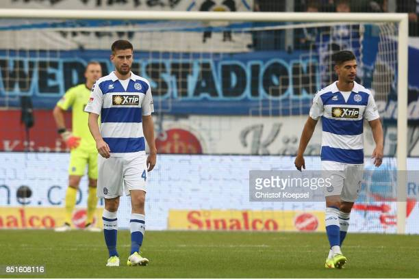Dustin Bomheuer and Enis Hajri of Duisburg look dejected after the first goal of Kiel during the Second Bundesliga match between MSV Duisburg and...