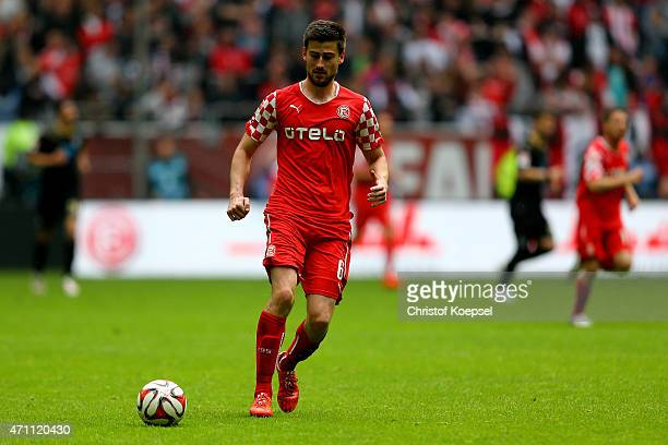 Dustin Bomheuer of Duesseldorf runs with the ball during the Second Bundesliga match between Fortuna Duesseldorf and 1860 Muenchen at EspritArena on...