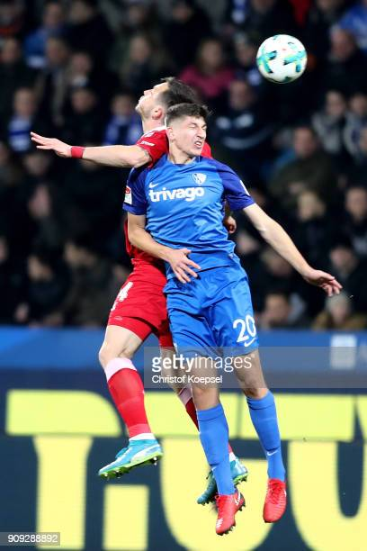 Dustin Bomheuer of Duisburg and Vitaly Janelt of Bochum go up for a header during the Second Bundesliga match between VfL Bochum 1848 and MSV...