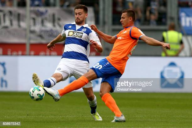 Dustin Bomheuer of Duisburg challenges Artur Sobiech of Darmstadt during the Second Bundesliga match between MSV Duisburg and SV Darmstadt 98 at...
