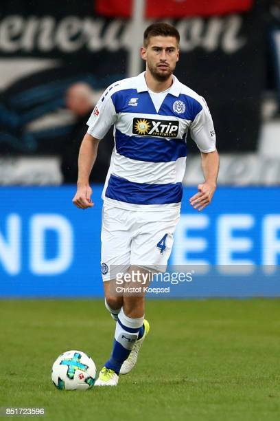 Dustin Bomheuer of Duisburg runs with the ball during the Second Bundesliga match between MSV Duisburg and Holstein Kiel at SchauinslandReisenArena...