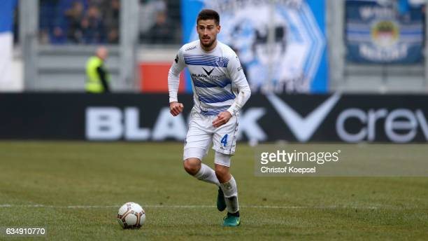 Dustin Bomheuer of Duisburg runs with the ball during the Third League match between MSV Duisburg and Preussen Muenster at SchauinslandreisenArena on...