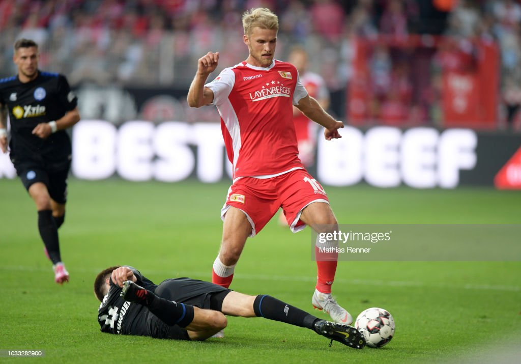 Dustin Bomheuer of MSV Duisburg and Sebastian Andersson of 1.FC Union Berlin during the game between Union Berlin and the MSV Duisburg at the Stadion an der Alten Foersterei on september 14, 2018 in Berlin, Germany.