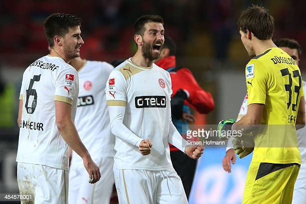 Dustin Bomheuer Stelios Malezas and goalkeeper Fabian Giefer of Duesseldorf celebrate winning after the Second Bundesliga match between 1 FC...