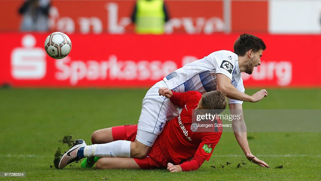Dustin Bomheur of Duisburg (top) tackles Tommy Grupe of Rostock during the third league match between MSV Duisburg and Hansa Rostock at Schauinsland-Reisen-Arena on October 22, 2016 in Duisburg, Germany.