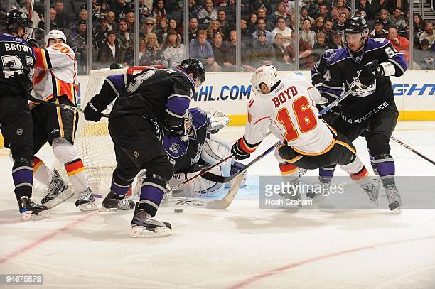 Dustin Boyd of the Calgary Flames loses his balance while attempting a shot during a game against the Los Angeles Kings at Staples Center on November...