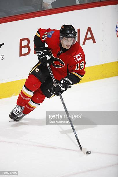 Dustin Boyd of the Calgary Flames skates with the puck during the game against the Colorado Avalanche on October 28 2008 at the Pengrowth Saddledome...