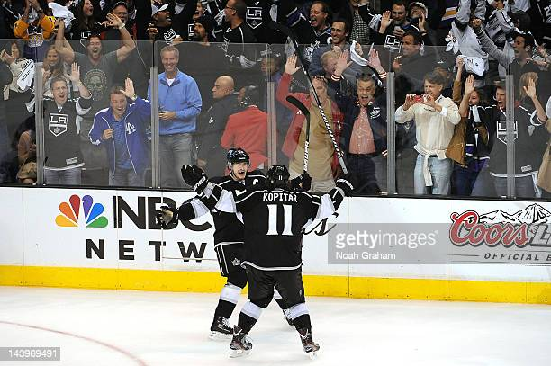 Dustin Brown and Anze Kopitar of the Los Angeles Kings celebrate after a goal against the St Louis Blues in Game Four of the Western Conference...