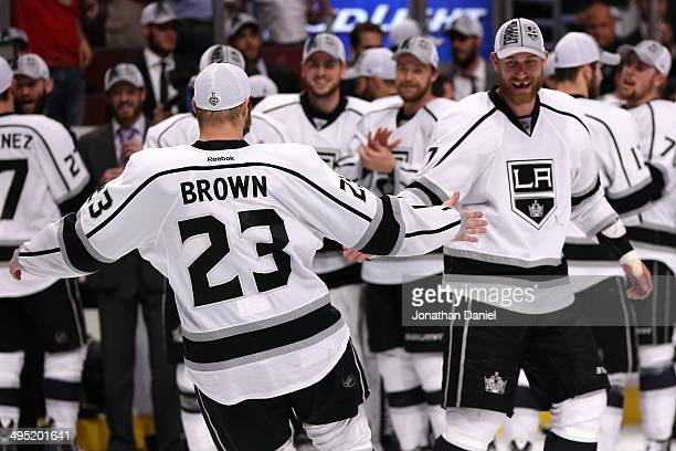Dustin Brown and Jeff Carter of the Los Angeles Kings celebrate defeating the Chicago Blackhawks 5 to 4 in overtime in Game Seven to win the Western...