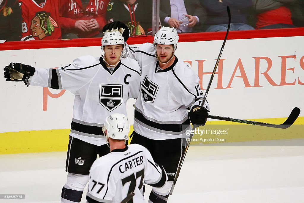 Dustin Brown #23 and Kyle Clifford #13 of the Los Angeles Kings react after Brown scored the Kings fourth goal in the third period of the NHL game against the Chicago Blackhawks at the United Center on March 14, 2016 in Chicago, Illinois.