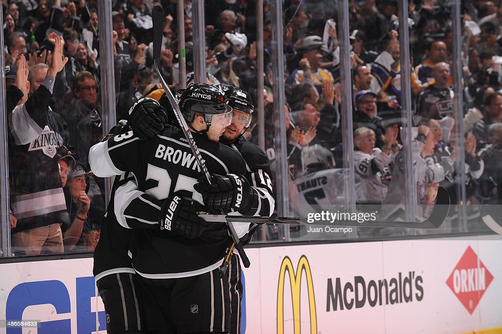 Dustin Brown #23 and Marian Gaborik #12 of the Los Angeles Kings celebrate in Game Four of the First Round of the 2014 Stanley Cup Playoffs against the San Jose Sharks at STAPLES Center on April 24, 2014 in Los Angeles, California.