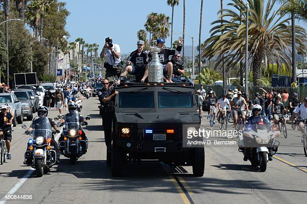 Dustin Brown and Tyler Toffoli of the Los Angeles Kings sit on a truck with the Stanley Cup during the Los Angeles Kings South Bay Victory Parade on...