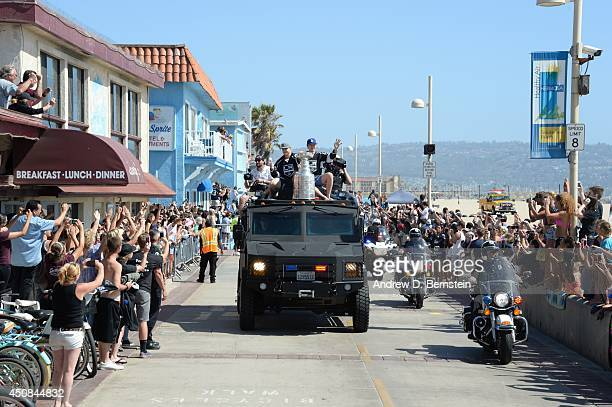 Dustin Brown and Tyler Toffoli of the Los Angeles Kings wave to fans during the Los Angeles Kings South Bay Victory Parade on June 18, 2014 in...