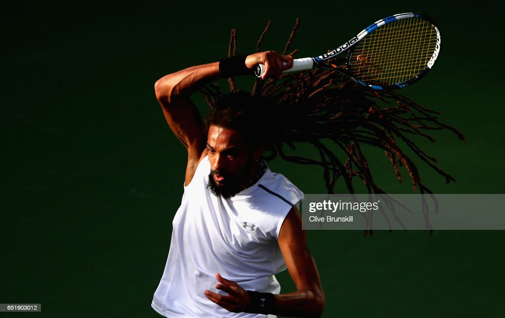 Dustin Brown of Germany in action against Dan Evans of Great Britain in their first round match during day five of the BNP Paribas Open at Indian Wells Tennis Garden on March 10, 2017 in Indian Wells, California.