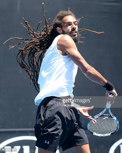 Dustin Brown of Germany plays a forehand in his first round doubles match with Albert RamosVinolas of Spain against Nenad Zimonjic and Mischa Zverev...