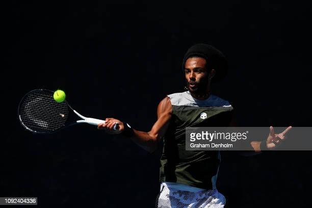 Dustin Brown of Germany plays a forehand in his match against Lloyd Harris of South Africa during Qualifying ahead of the 2019 Australian Open at...