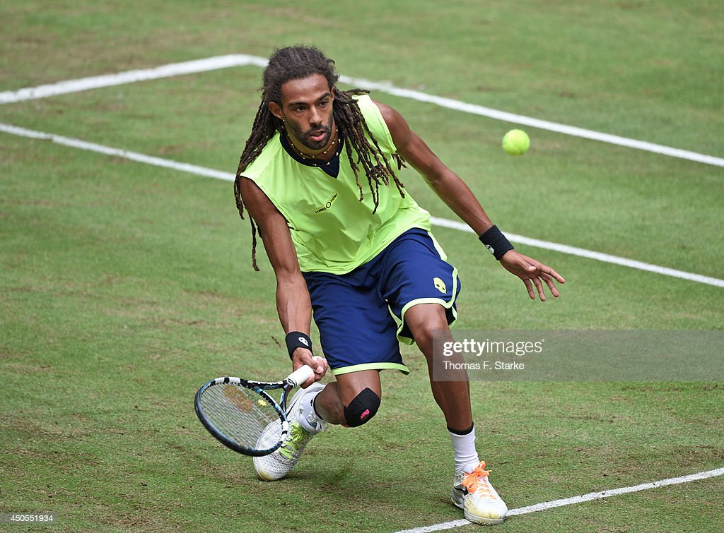 Dustin Brown of Germany plays a forehand in his match against Philipp Kohlschreiber of Germany during day five of the Gerry Weber Open at Gerry Weber Stadium on June 13, 2014 in Halle, Germany.
