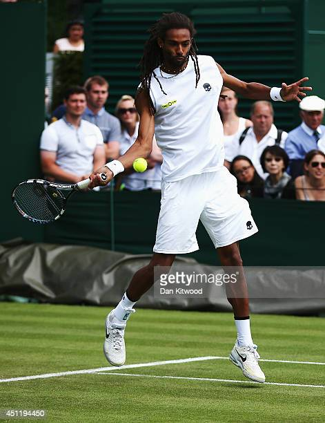Dustin Brown of Germany plays a shot during his Gentlemen's Doubles first round match with JanLennard Struff against Ken Skupski and Neal Skupski of...