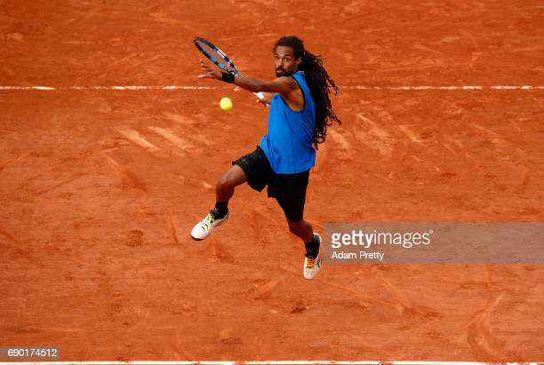 Dustin Brown of Germany returns the ball during the mens singles first round match against Gael Monfils of France on day three of the 2017 French...