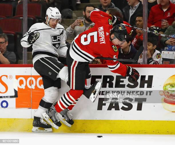 Dustin Brown of the Los Angeles Kings and Connor Murphy of the Chicago Blackhawks battle for the puck along the boards at the United Center on...