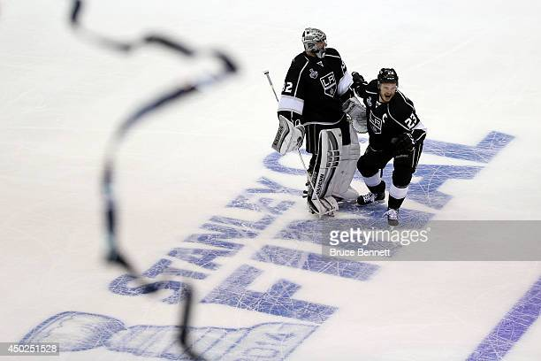 Dustin Brown of the Los Angeles Kings and goaltender Jonathan Quick celebrate Brown's double overtime game winner against the New York Rangers during...